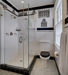 small bathroom with a shower cubicle and a toilet